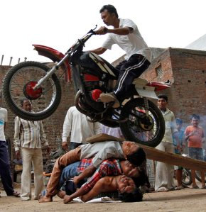 Guys performing stunt - 134th Rathyatra in Ahmedabad